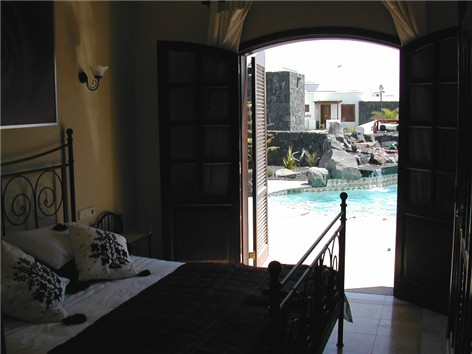 Master Bedroom Patio Doors lead to Pool / Terrace