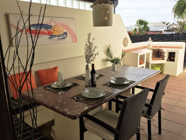 Al-Fresco dining area to side of the villa with BBQ